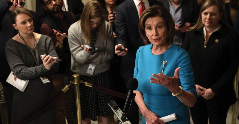Pelosi held a briefing on the Coronavirus Aid Package Bill that will deal with the outbreak of COVID-19. Photo by Alex Wong Getty Images.jpg