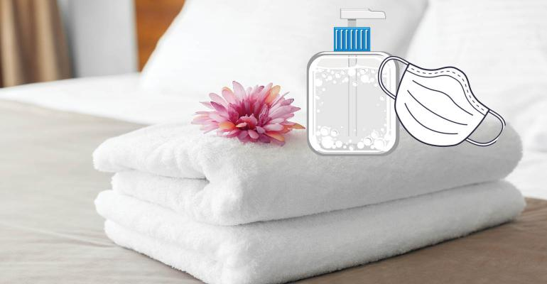 corona virus protection in a hotel room-mask and hand sanitizer.jpg