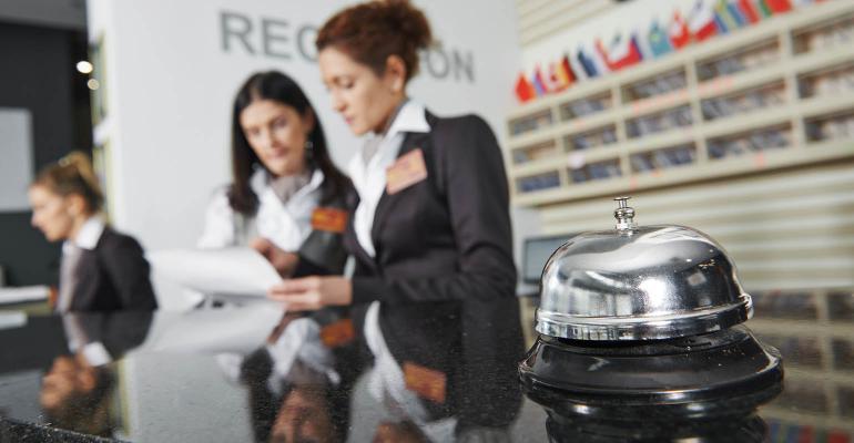 hotel-front-desk-GettyImages-523181955-1540.jpg