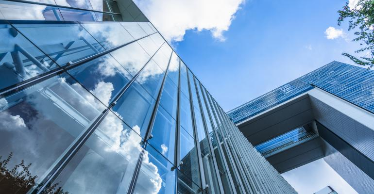 office bldg glass clouds reflected-ts-621261046.jpg
