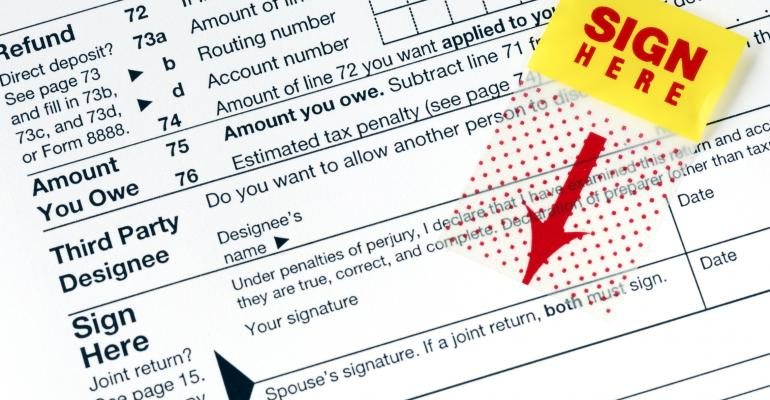 tax-form-sign-here.jpg