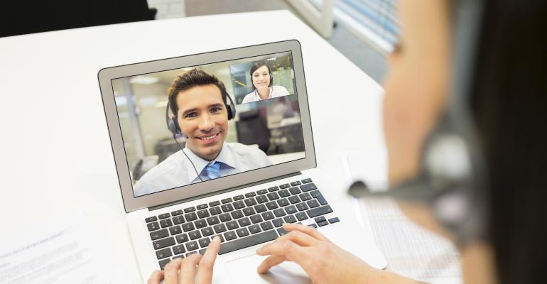tech virtual business meeting via skype Getty Images-466604219.jpg