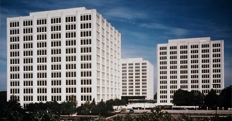 GlenStar, Walton Buy 40%-Vacant Towers for $58M