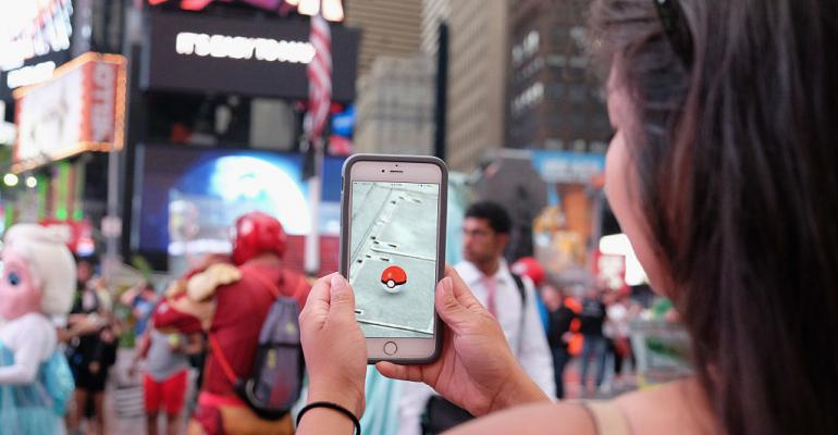Pokemon Go on phone in Times Square
