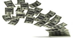 floating-money into a stack-595x335.jpg