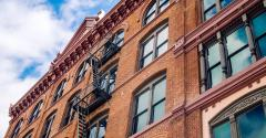 apartment bldg-old-brick_GettyImages-812706946.jpg