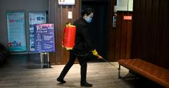 A staff disinfects the lobby of a hotel in Jiujiang in China's central Jiangxi province.