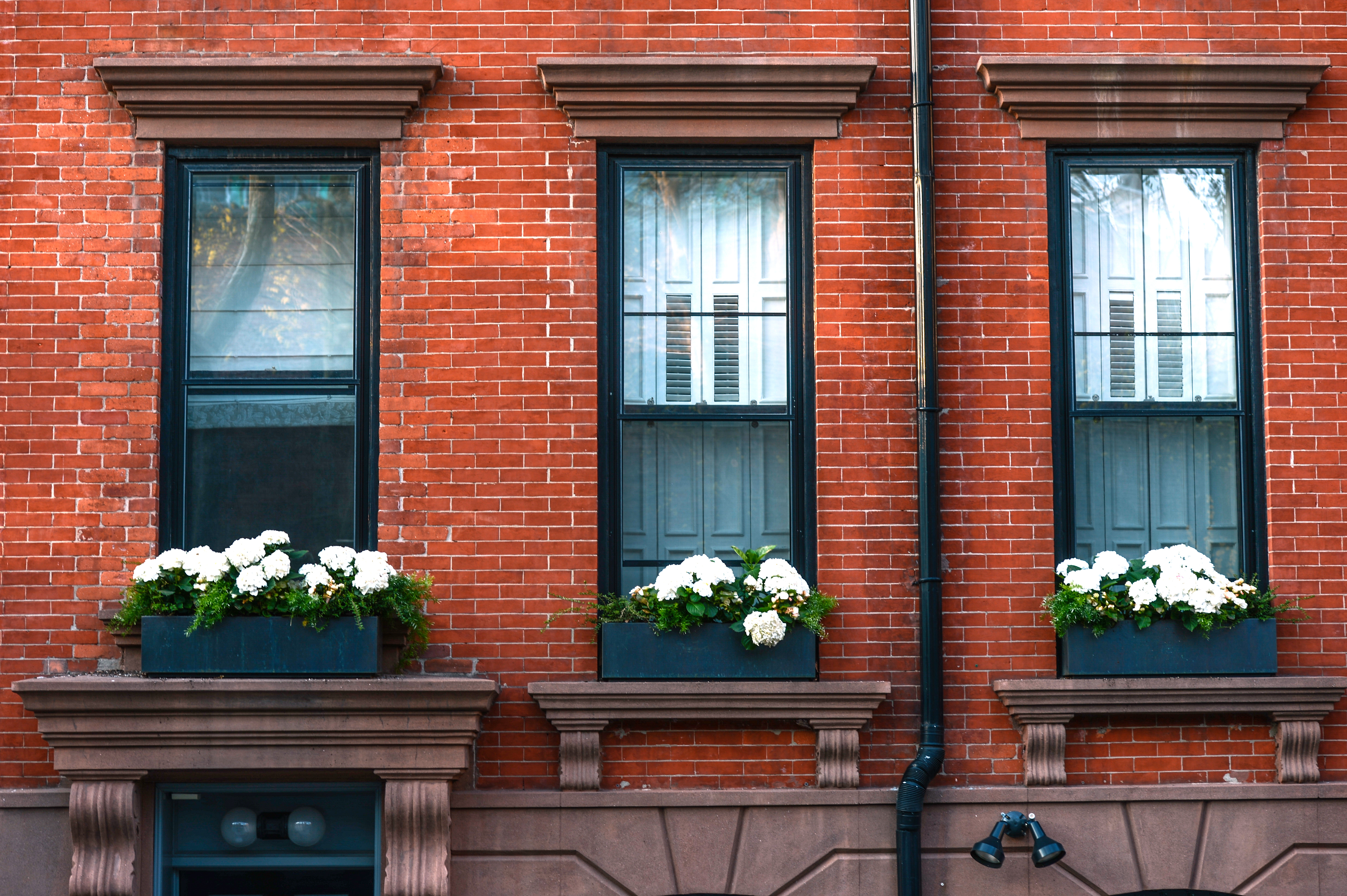 Brick Apartment Building Window investors see opportunity in value-add strategies for class-b